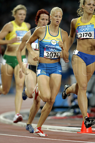 21 August 2004: Swedish heptathlete Carolina Kluft (SWE) running in the Women's Heptathlon 800m held in the Olympic Stadium. Kluft went on to win the gold medal with a score of 6952 points. 2004 Olympic Games, Athens, Greece. Photo: Neil Tingle/Action Plus...040821 olympics olympic athletics  run runner runners running distance woman women women's .female