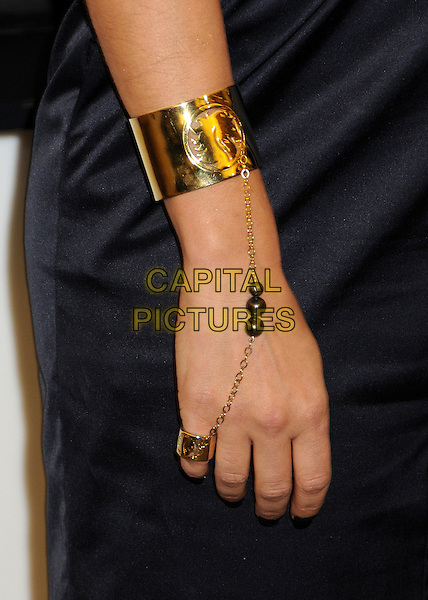 FERGIE aka STACY FERGUSON .At the VIVA GLAM VI Special Edition Lipstick Launch, M.A.C Cosmetics Store,Robertson Blvd., Los Angeles, CA, USA, 5th March 2009. .MAC arm hand detail beads gold ring attached to chain bracelet cuff  Stacey Black Eyed Peas.CAP/ADM/BP.©Byron Purvis/Admedia/Capital PIctures