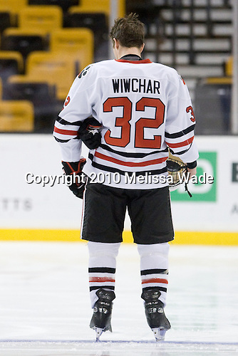 Dylan Wiwchar (NU - 32) - The Northeastern University Huskies defeated the Harvard University Crimson 4-1 (EN) on Monday, February 8, 2010, at the TD Garden in Boston, Massachusetts, in the 2010 Beanpot consolation game.