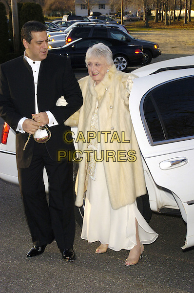 FRANK BASILE & CELESTE HOLM.Recipient of the Lifetime Achievement Award for Acting. .The fifth annual Garden State Film Festival awards dinner at The English Manor, Ocean, New Jersey, USA..March 25th, 2007.full length black car white cream dress coat fur holding hands.CAP/ADM/BL.©Bill Lyons/AdMedia/Capital Pictures *** Local Caption ***