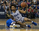 Nevada guard Nisre Zouzoua (5)scrambles for a loose ball against South Dakota State in the second half of an NCAA college basketball game in Reno, Nev., Saturday, Dec. 15, 2018. (AP Photo/Tom R. Smedes)