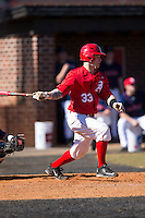 Kevin Elefante (33) of the Belmont Abbey Crusaders follows through on his swing against the Shippensburg Raiders at Abbey Yard on February 8, 2015 in Belmont, North Carolina.  The Raiders defeated the Crusaders 14-0.  (Brian Westerholt/Four Seam Images)