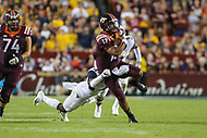 Landover, MD - September 3, 2017: Virginia Tech Hokies quarterback Josh Jackson (17) tries to break a tackle during game between Virginia Tech and WVA at  FedEx Field in Landover, MD.  (Photo by Elliott Brown/Media Images International)