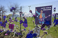 Prince's Live Your Dreams! poster on memorial fence playing Love Symbol guitar. Paisley Park Studios Chanhassen Minnesota MN USA