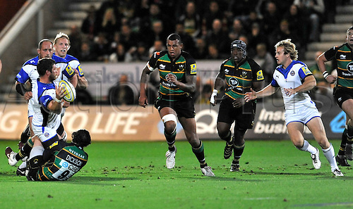 17.09.2010. Aviva Premiership Rugby Round 3 Northampton Saints v Bath Rugby at Franklin's Gardens, Northampton, England. Luke Watson (Captain) of Bath Rugby clears the ball to Nick Abendanon of Bath Rugby.