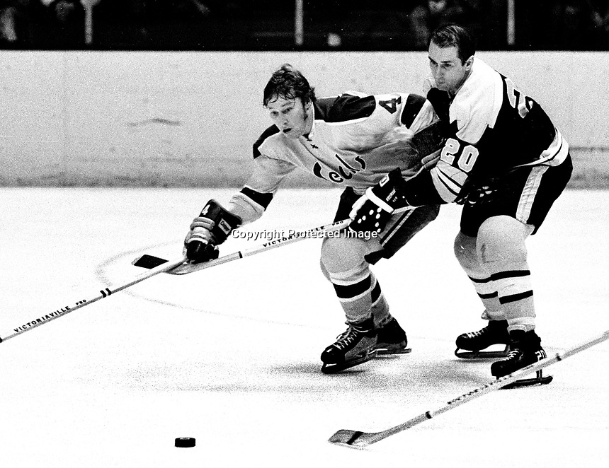 Seals Dick Redmond and Boston Bruins Dallas Smith battle (1971 photo/Ron Riesterer)