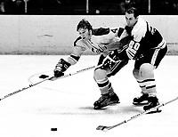 Seals Dick Redmond and Boston Bruins Dallas Smith battle (1971 photo/Ron Riesterer)
