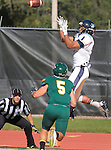 SEPTEMBER 13, 2014 -- Tim Crenshaw #1 of South Dakota Mines leaps for a reception in front of Black Hills State defender Brian Baldwin #5 during their college football game Saturday at Lyle Hare Stadium in Spearfish, S.D.  (Photo by Dick Carlson/Inertia)