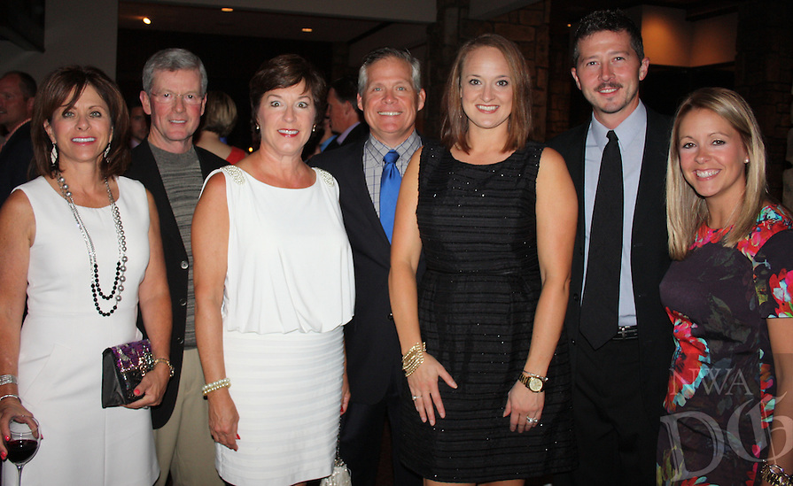 STAFF PHOTO CARIN SCHOPPMEYER Karen and Paul Mahan, from left, Susan and Stu Todd, Andy and Jeremy Pratt and Amanda Whitaker enjoy the Charity Challenge of Champions dinner and auction.