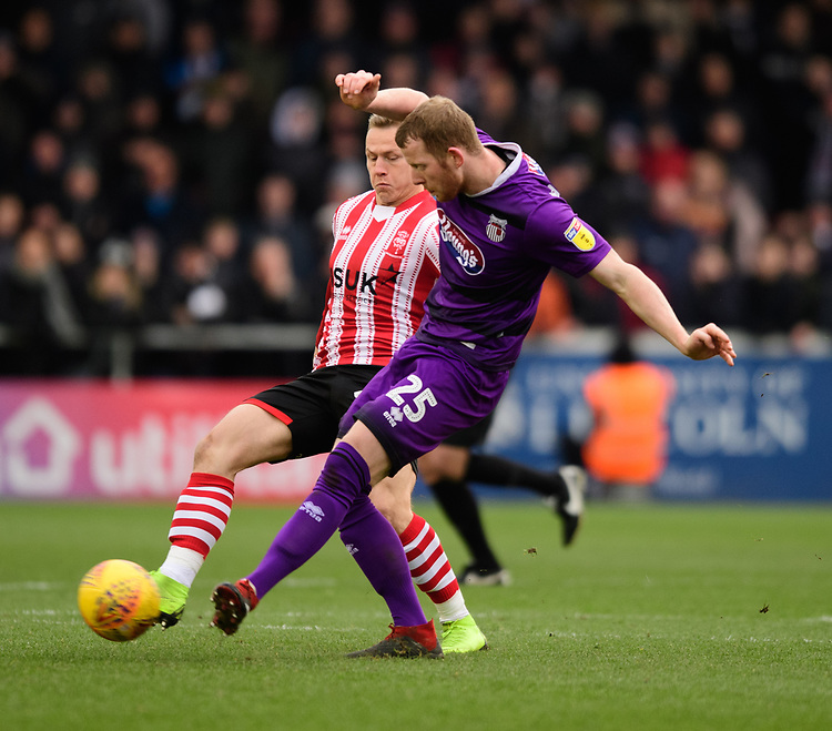 Grimsby Town's Alex Whitmore under pressure from Lincoln City's Danny Rowe<br /> <br /> Photographer Chris Vaughan/CameraSport<br /> <br /> The EFL Sky Bet League Two - Lincoln City v Grimsby Town - Saturday 19 January 2019 - Sincil Bank - Lincoln<br /> <br /> World Copyright © 2019 CameraSport. All rights reserved. 43 Linden Ave. Countesthorpe. Leicester. England. LE8 5PG - Tel: +44 (0) 116 277 4147 - admin@camerasport.com - www.camerasport.com