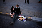 Paris, France.May 6, 2007..At The Place de la Concorde a  young couple sit with a placard of Socialist presidential candidate Segolene Royal as the celebration goes on around them for right-winger candidate Nicolas Sarkozy who claimed 53% of the vote while Royal 47%.....