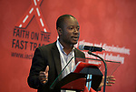 """Edmund Owusu of Shiva speaks to the July 21 opening session of """"Faith Building Bridges"""" in Amsterdam, the Netherlands. The July 21-22 interfaith event, sponsored by the World Council of Churches-Ecumenical Advocacy Alliance, was held on the eve of the 2018 International AIDS Conference."""