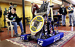 WOODBURY CT. 16 March 2018-031619SV09-Jonah Biron, 17, of Bethlehem, left, downloads a software update for the robot during the Power Surge 4-H Robotocs team open house at the Power Station Braxton Engineering Building in Woodbury Saturday.<br /> Steven Valenti Republican-American