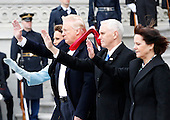 First Lady Melania Trump, United States President Donald Trump, Vice President Mike Pence and Karen Pence wave at Marine One as it takes off with former U.S. President Barack Obama on the east front steps of the Capitol Building after Trump is sworn in at the 58th Presidential Inauguration on Capitol Hill in Washington, D.C. on January 20, 2017.  <br /> Credit: John Angelillo / Pool via CNP