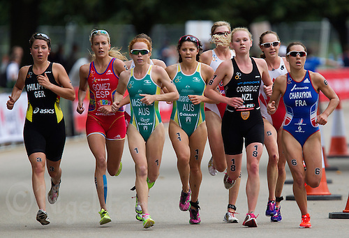 12 SEP 2013 - LONDON, GBR - The lead women's run pack including eventual winner Charlotte McShane (AUS) (third from the left) of Australia, makes their way through Hyde Park in London, Great Britain during the under 23 women's ITU 2013 World Triathlon Championships in  (PHOTO COPYRIGHT © 2013 NIGEL FARROW, ALL RIGHTS RESERVED)