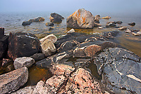 Large rocks and bolders on shoreline of Lake Superior in fog at Katherine Cove <br />Lake Superior Provincial Park<br />Ontario<br />Canada