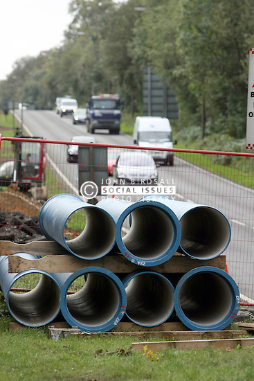 Installing a new water main A217 Burgh Heath,Pipes waiting to be laid.