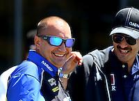 Jul. 28, 2013; Sonoma, CA, USA: NHRA top fuel dragster driver Brandon Bernstein (left) talks with Sheikh Khalid Bin Hamad Al Thani during the Sonoma Nationals at Sonoma Raceway. Mandatory Credit: Mark J. Rebilas-