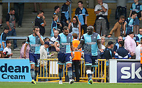 Adebayo Akinfenwa of Wycombe Wanderers has words with Paul Hayes (centre) of Wycombe Wanderers & Michael Harriman of Wycombe Wanderers after the supporters appear to confront the players during the Sky Bet League 2 match between Wycombe Wanderers and Colchester United at Adams Park, High Wycombe, England on 27 August 2016. Photo by Andy Rowland.
