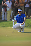 Louis Oosthuizen lines up his putt on the18th during the final round of the Dubai World Championship on the Earth Course at the Jumeirah Golf Estate, Dubai..Picture Fran Caffrey/www.golffile.ie.