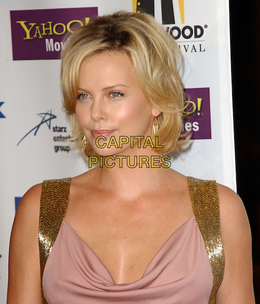 CHARLIZE THERON.The 9th Annual Hollywood Film Festival Awards Gala held at The Beverly Hills Hilton in Beverly Hills, California  .October 24th, 2005.Ref: DVS.headshot portrait gold straps.www.capitalpictures.com.sales@capitalpictures.com.Supplied By Capital PIctures
