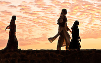 Women taking a walk along the ramparts and enjoying the sunset. (Photo by Matt Considine - Images of Asia Collection)