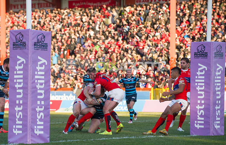 Picture by Allan McKenzie/SWpix.com - 08/02/2015 - Rugby League - First Utility Super League - Hull Kingston Rovers v Leeds Rhinos - KC Lightstream Stadium, Hull, England - Hull KR's James Donaldson holds up Leeds's Brad Singleton at the goal line, First Utility, branding.