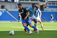 Anthony Knockaert of Brighton & Hove Albion (left) and Jordan Lukaku of Lazio (right)  during the Friendly match between Brighton and Hove Albion and Lazio at the American Express Community Stadium, Brighton and Hove, England on 31 July 2016. Photo by Edward Thomas / PRiME Media Images.