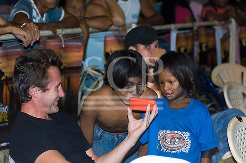 "Altamira, Brazil. ""Xingu Vivo Para Sempre"" protest meeting about the proposed Belo Monte hydroeletric dam and other dams on the Xingu river and its tributaries. Bruce Parry sharing some fun with Indian children."
