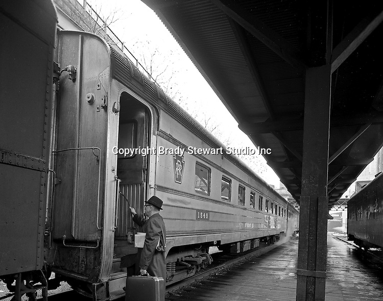 Pittsburgh PA:  Businessman boarding a passenger commuter train at the Pittsburgh's Penn Station - 1955.