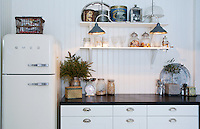 A retro SMEG fridge is a feature of this simple white kitchen