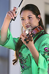 Ingrid Carlson, 20, performs at the Chinese New Year Celebration at the Nevada State Museum in Carson City, Nev., on Saturday, Feb. 16, 2018. <br />