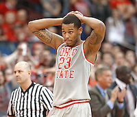 Ohio State Buckeyes center Amir Williams (23) reacts after fouling a Michigan player in the act of shooting a three point shot in second half action at Nationwide Arena on February 11,  2014. (Chris Russell/Dispatch Photo)