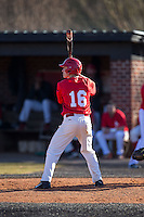 Matt McGarry (16) of the Belmont Abbey Crusaders at bat against the Shippensburg Raiders at Abbey Yard on February 8, 2015 in Belmont, North Carolina.  The Raiders defeated the Crusaders 14-0.  (Brian Westerholt/Four Seam Images)