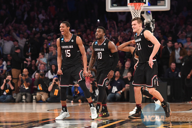 NEW YORK, NY - MARCH 26: PJ Dozier #15, Duane Notice #10 and Maik Kotsar #21 of the South Carolina Gamecocks during a game against the Florida Gators during the 2017 NCAA Men's Basketball Tournament held at Madison Square Garden on March 26, 2017 in New York City. (Photo by Justin Tafoya/NCAA Photos via Getty Images)