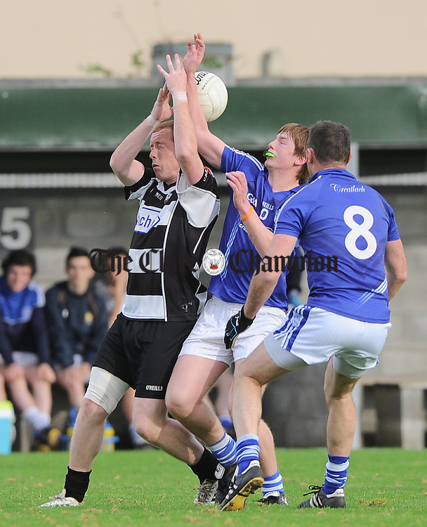 Tola Crowe of Clarecastle in action against Conor Deasy and Conor Earley of Cratloe during their Junior B county football final in Shannon. Photograph by John Kelly.