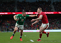 8th February 2020; Aviva Stadium, Dublin, Leinster, Ireland; International Six Nations Rugby, Ireland versus Wales; Andrew Conway (Ireland) hands off a tackle from Johnny McNicholl (Wales)