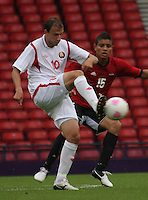 Men's Olympic Football match Egypt v Belarus on 1.8.12...Renan Bardini Bressan of Belarus and Saadeldin Saad of Egypt, during the Men's Olympic Football match between Egypt v Belarus at Hampden Park, Glasgow.