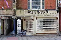 Pictured: Mano's take away with its shutters closed in Wind Street, Swansea, Wales, UK. Saturday 21 March 2020<br /> Re: Covid-19 Coronavirus pandemic, UK.