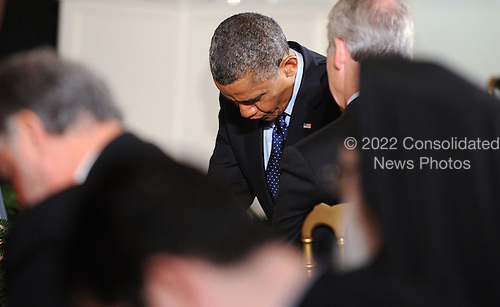 United States President Barack Obama bows his head in prayer during the Easter Prayer Breakfast at the White House April 5, 2013 in Washington, DC. The annual Easter Prayer Breakfast brings together Christian leaders from across the United States to celebrate the arrival of Easter..Credit: Olivier Douliery / Pool via CNP