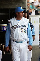 Myrtle Beach Pelicans hitting coach Julio Garcia in the dugout during  a game vs. the Salem Red Sox at BB&T Coastal Field in Myrtle Beach, South Carolina on May 26, 2011.   Photo By Robert Gurganus/Four Seam Images
