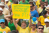 A protester carries a hand-written placard 'Incometence No, Ignorance No, Corruption No, PT [Workers' Party] Out'. Rio de Janeiro, Brazil, 15th March 2015. Popular demonstration against the President, Dilma Rousseff in Copacabana. Photo © Sue Cunningham sue@scphotographic.com.