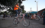 Eddie Fruend rides his home-made double-decker bike outside the Timbers Saloon during the first annual Blinky Man event in downtown Carson City, Nev., on Wednesday, June 19, 2013.<br /> Photo by Cathleen Allison