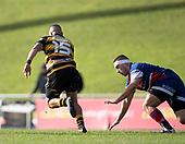 Reece Joyce makes a telling break past Lachlan Douglas. Counties Manukau Premier 1 McNamara Cup Final between Ardmore Marist and Bombay, played at Navigation Homes Stadium on Saturday July 20th 2019.<br />  Bombay won the McNamara Cup for the 5th time in 6 years, 33 - 18 after leading 14 - 10 at halftime.<br /> Photo by Richard Spranger.