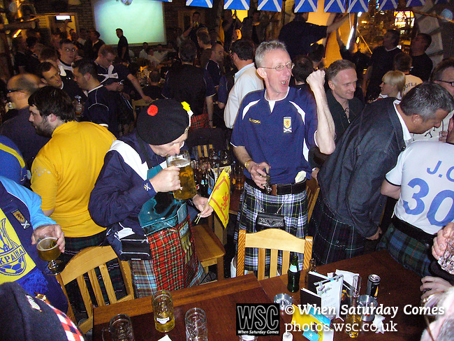Ukraine 2 Scotland 2, 11/10/2006. Olympic Stadium, Euro 2008 Qualifying. Scotland fans, known as the Tartan Army, singing in a bar in Kiev prior to their team's match against Ukraine. Ukraine defeated Scotland 2-0 after a goal-less first half in this Euro 2008 group qualifying match played at the Olympic Stadium in Kyiv (Kiev). This was the first competitive international match between the countries. Photo by Colin McPherson.
