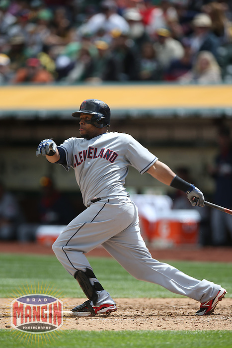 OAKLAND, CA - APRIL 2:  Carlos Santana #41 of the Cleveland Indians bats against the Oakland Athletics during the game at O.co Coliseum on Wednesday, April 2, 2014 in Oakland, California. Photo by Brad Mangin