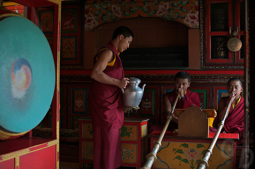 Buddhist Monks during a ceremony at a small Monastery at Boudhanath Kathmandu also known as little Tibet, Nepal
