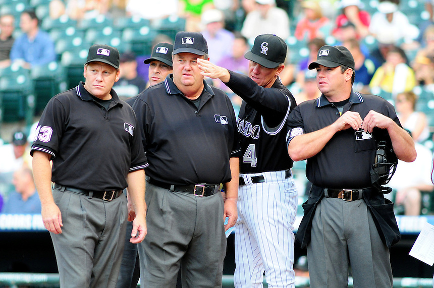 July 9, 2009: Rockies manager and 2009 National League Manager of the Year candidate Jim Tracy, 2nd from right, has a discussion with the umpiring crew (HP: Rob Drake. 1B: Paul Schrieber. 2B: Paul Nauert. 3B: Joe West) prior to a regular season game between the Atlanta Braves and the Colorado Rockies at Coors Field in Denver, Colorado.