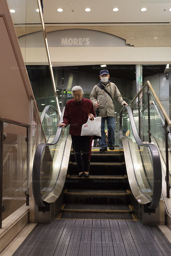 The world's shortest escalator in the basement of More's Department store  in Kawasaki Kanagawa, Japan. Sunday April 5th 2015