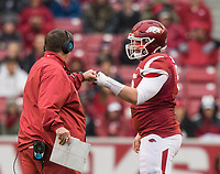 Hawgs Illustrated/BEN GOFF <br /> Jake Raulerson fist-bumps coach Bret Bielema as he comes in to play ceneter for Arkansas after starter Zach Rogers went out with an injury in the first quarter against Mississippi State Saturday, Nov. 18, 2017, at Reynolds Razorback Stadium in Fayetteville.